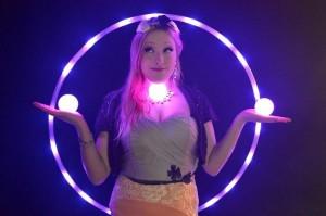 Bella with glow hoop and glow juggle balls