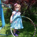 baby with hula hoops