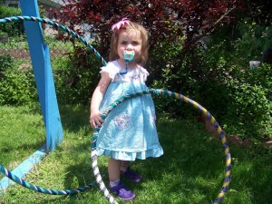 baby with hula hoops