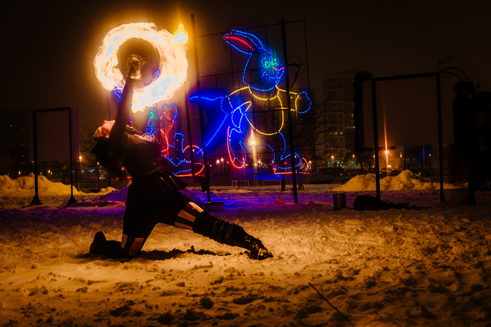 Lucy Loop fire poi dancing in Barrie's Winterfest 2015