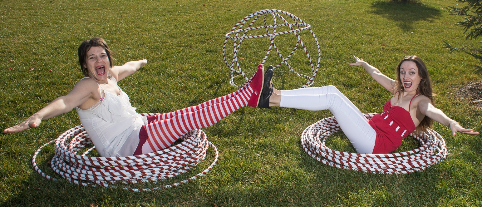 Canada 150 hula hoopers sitting in red and white hoops